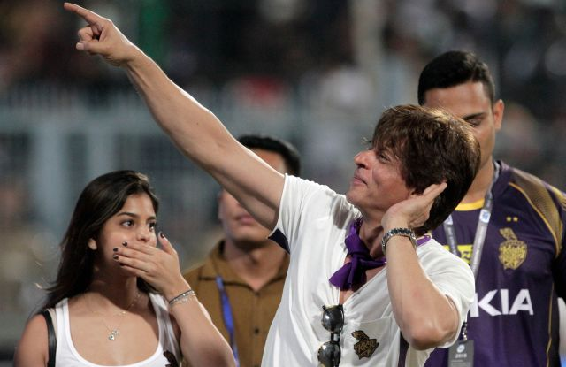 Bollywood actor and co-owner of Kolkata Knight Riders Shah Rukh Khan gestures towards the crowd as he walks around the venue with his daughter Suhana Khan after his team won the match against Royal Challengers Bangalore in the VIVO IPL cricket T20 match against Royal Challengers Bangalore in Kolkata, IndiaCricket VIVO IPL 2018, Kolkata, India - 08 Apr 2018