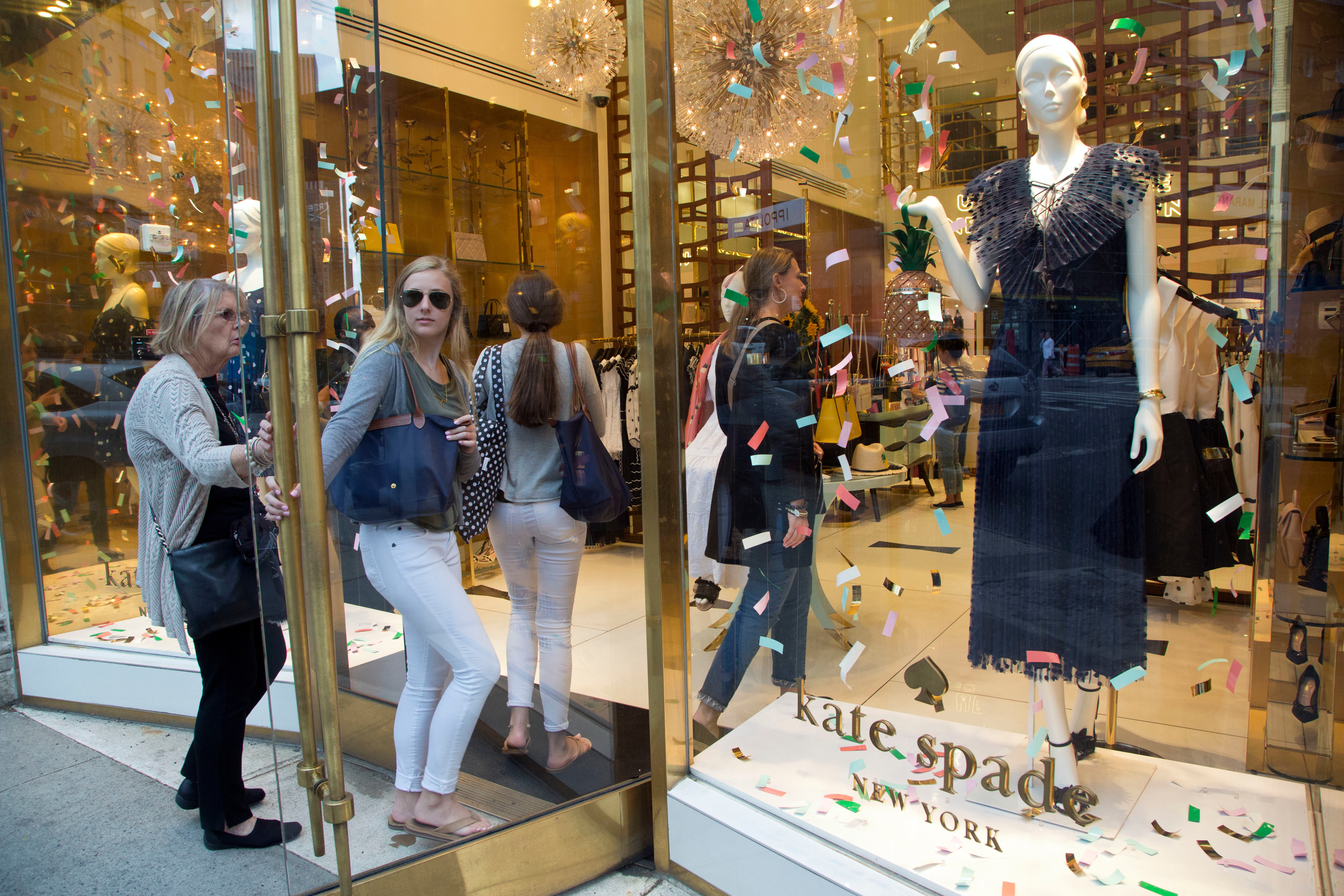 Shoppers enter the Kate Spade Madison Avenue store, in New York. Law enforcement officials say fashion designer Kate Spade has been found dead in her apartment in an apparent suicideKate Spade Death, New York, USA - 05 Jun 2018