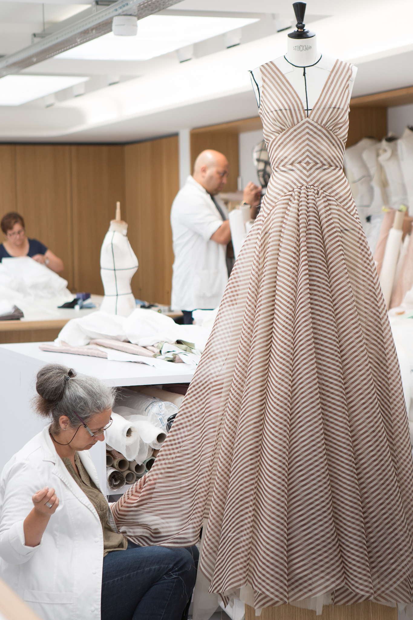 Workers in the Dior couture workshop.