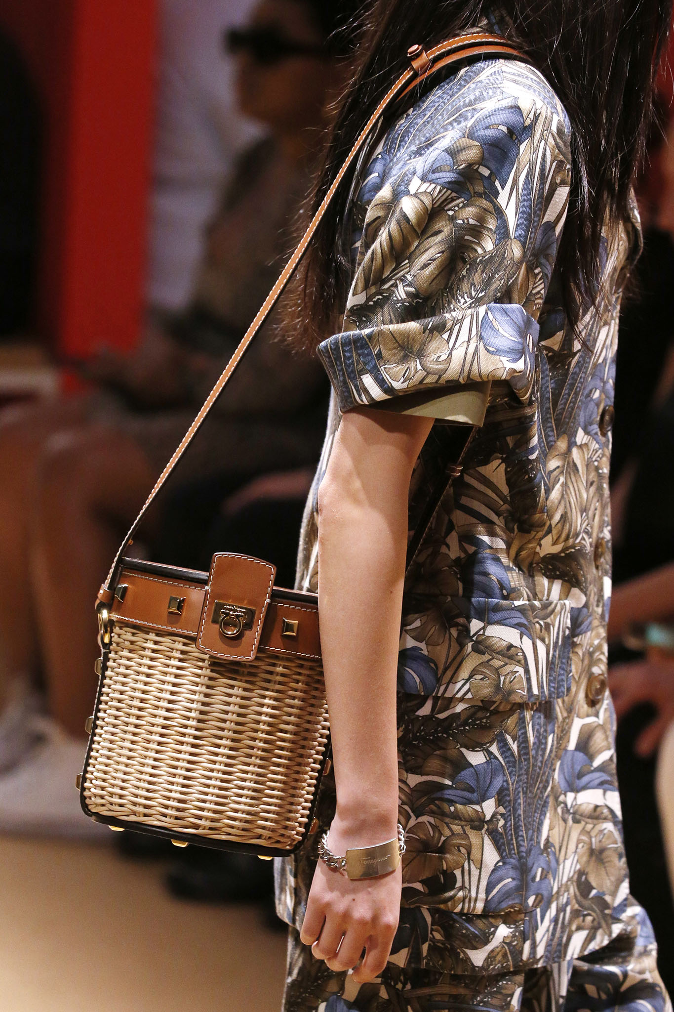 Salvatore Ferragamo women's creative director Paul Andrew updated the classic straw bucket bag with sophisticated leather inserts, metallic studs and the brand's signature Gancini detail. Charming as a Mediterranean summer.