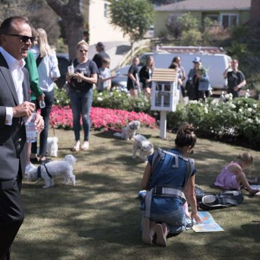 Rick Caruso walks the great lawn at Palisades Village