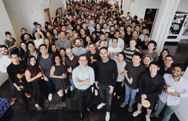 Instagram founders Kevin Systrom and Mike Krieger (center) with their team.