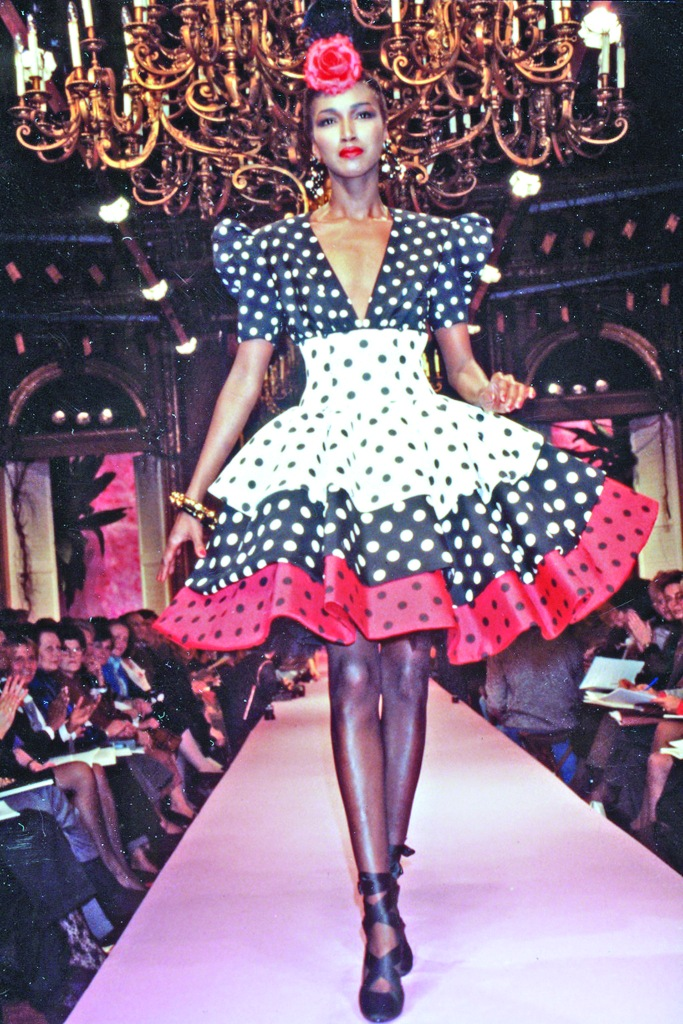Model wearing a polka-dot dress from Jean Patou spring 1987 collection designed by Christian Lacroix on the runway
