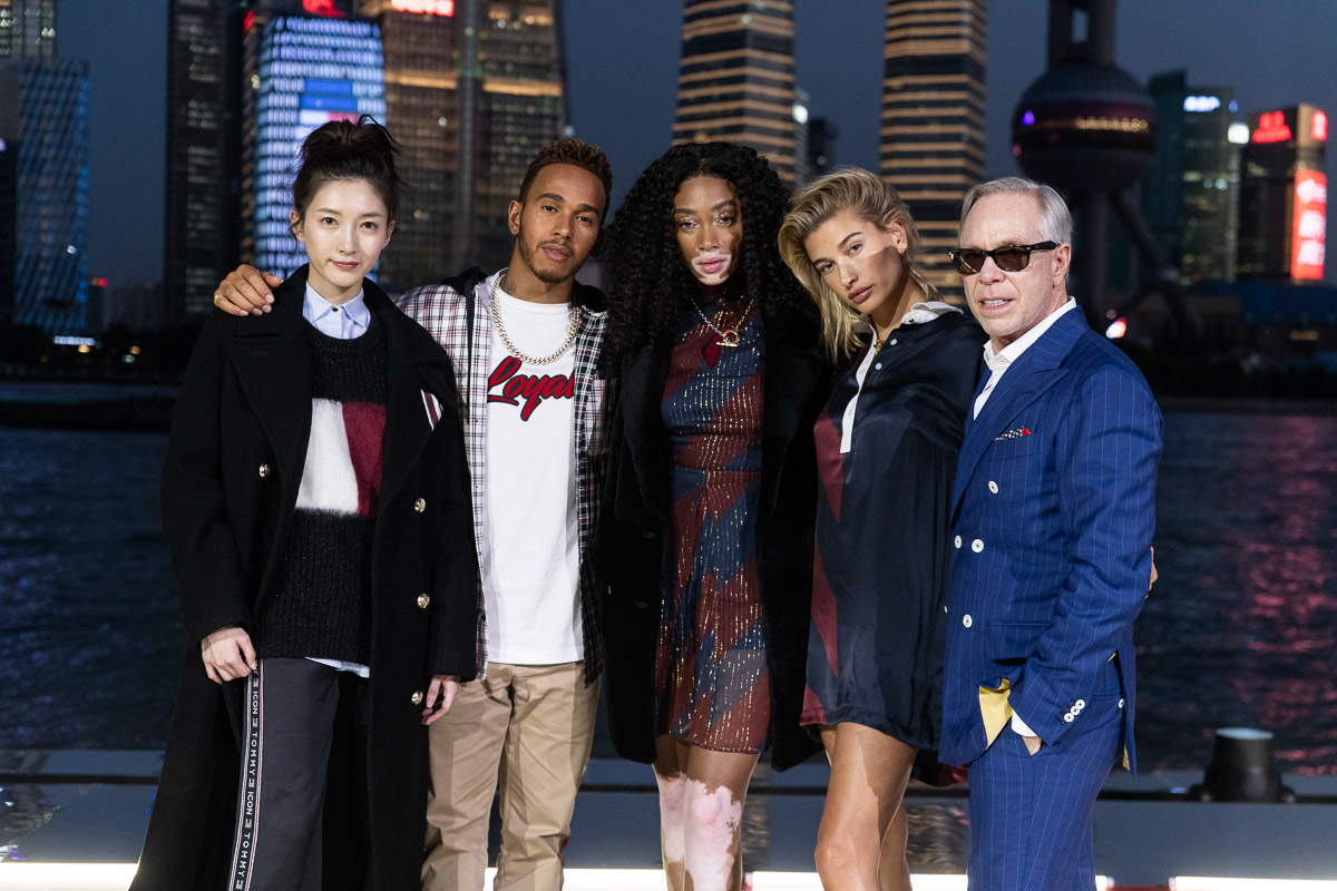 From left to right: Maggie Jiang, Lewis Hamilton, Winnie Harlow, Hailey Baldwin, and Tommy Hilfiger.
