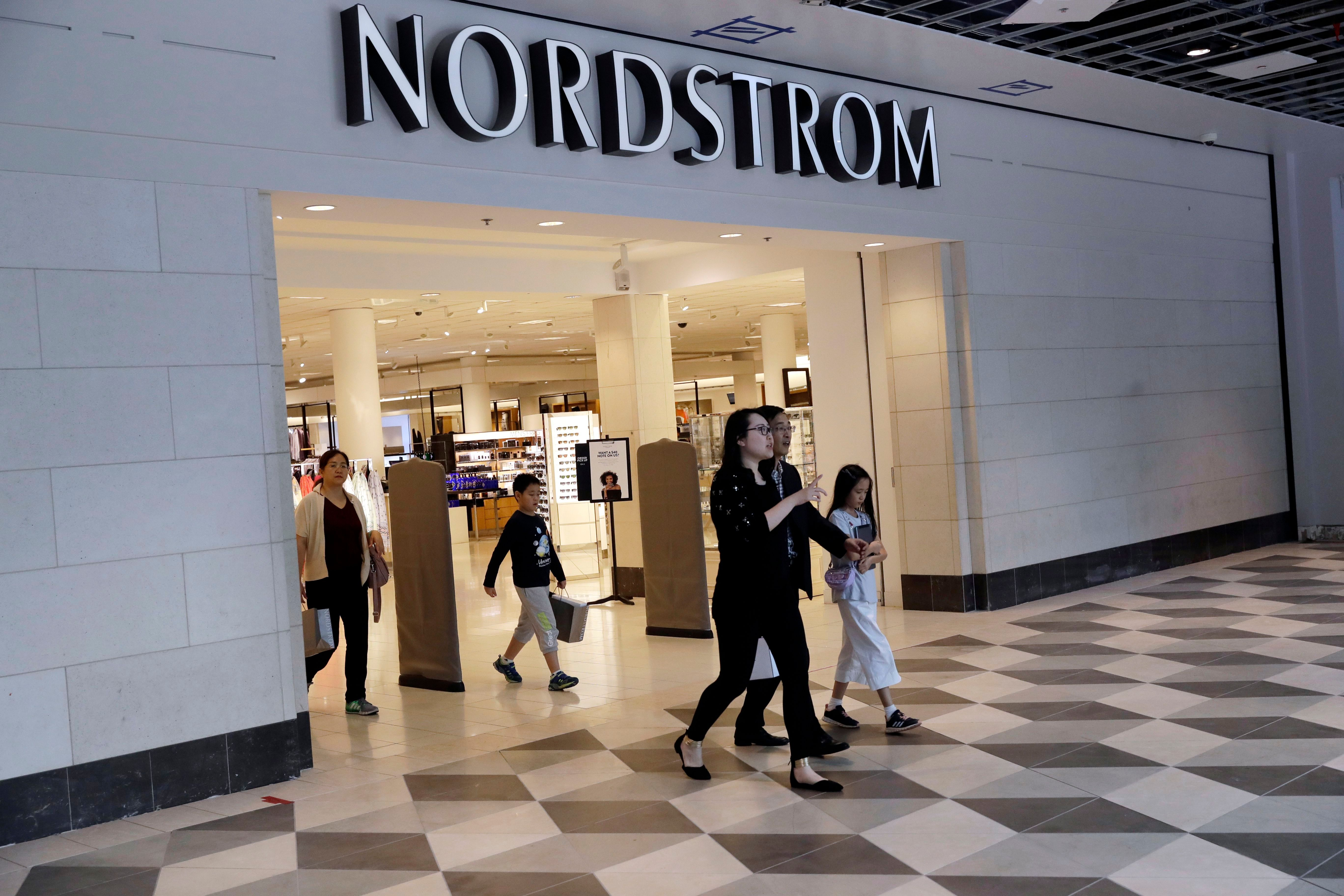 "In this Aug. 23, 2017, photo, shoppers exit a Nordstrom store in San Jose, Calif. Department store operator Nordstrom said, it had rejected a takeover offer from members of the Nordstrom family, calling the price ""inadequateNordstrom Buyout, San Jose, USA - 23 Aug 2017"
