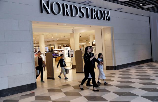 """In this Aug. 23, 2017, photo, shoppers exit a Nordstrom store in San Jose, Calif. Department store operator Nordstrom said, it had rejected a takeover offer from members of the Nordstrom family, calling the price """"inadequateNordstrom Buyout, San Jose, USA - 23 Aug 2017"""