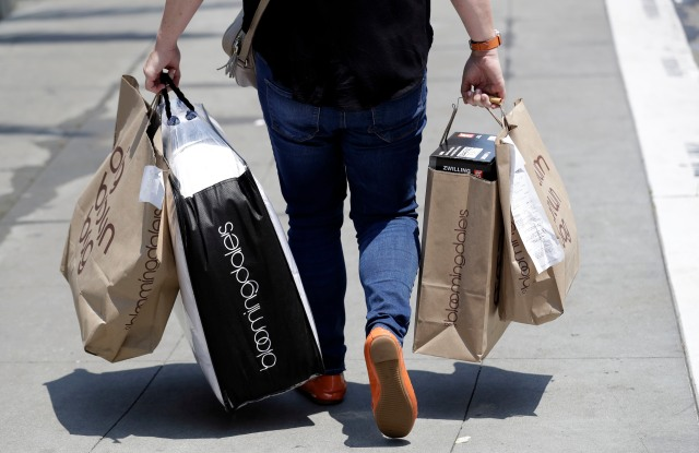A shopper carries bags in San Francisco. On Monday, July 16, the Commerce Department releases U.S. retail sales data for JuneRetail Sales, San Francisco, USA - 03 Jul 2018