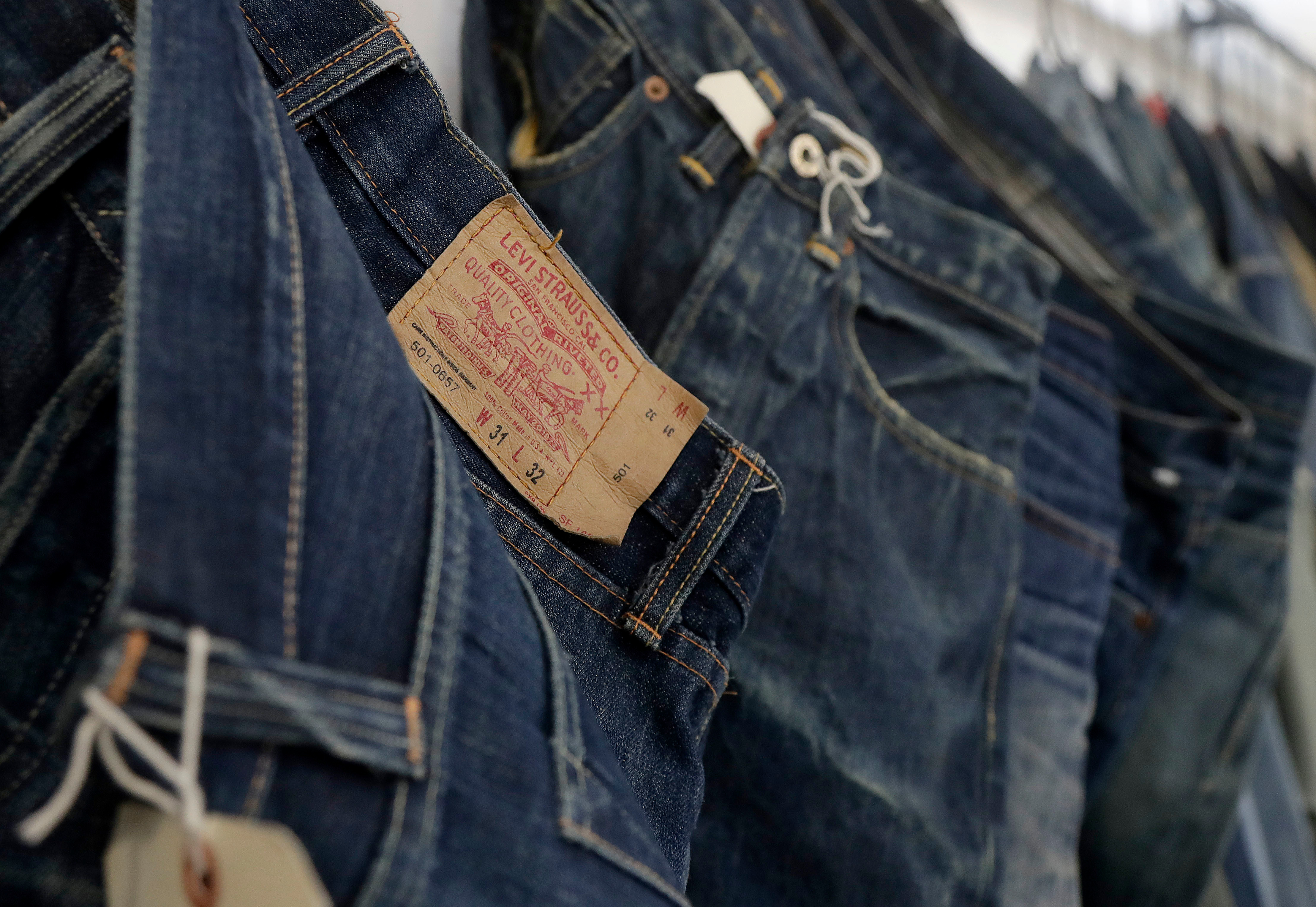 This photo shows Levi's jeans hanging on a wall at Levi's innovation lab in San Francisco. The process of making and selling an item of clothing is speeding up, as shoppers want products faster and faster in the age of Amazon. Companies like Tommy Hilfiger and Levi Strauss are digitizing different steps, like creating digital showrooms for buyers who place orders based on computerized rendering of a garment or producing 3D samples that are emailed to factories, instead of waiting for a physical prototypeDigital Fashion, San Francisco, USA - 09 Feb 2018