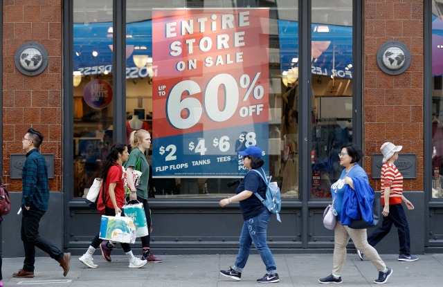 Shoppers walk past sale signs in San Francisco. On Wednesday, Aug 15, the Commerce Department releases U.S. retail sales data for JulyRetail Sales, San Francisco, USA - 03 Jul 2018