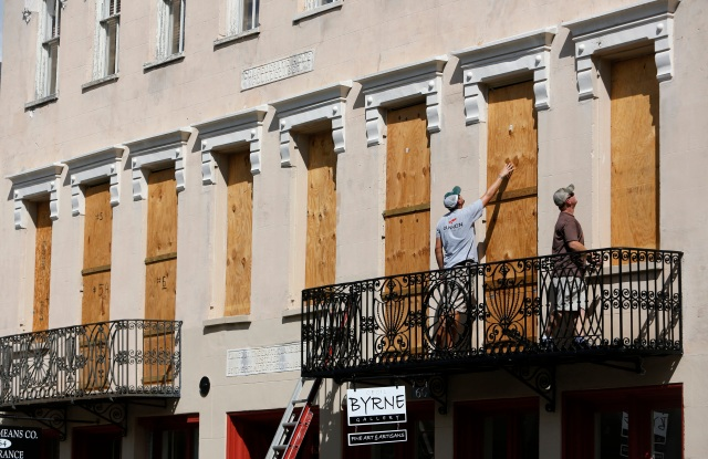 Derek Mundy, left, and Kris Crouse boards up the Confederate House in preparation for Hurricane Florence in downtown Charleston, S.CTropical Weather South Carolina, Charleston, USA - 11 Sep 2018
