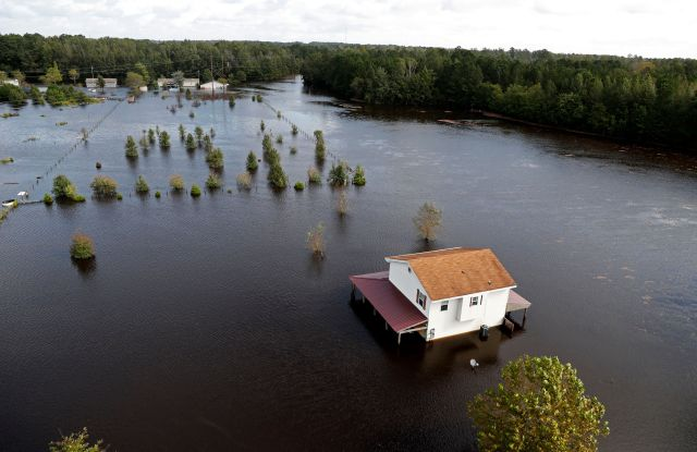 A house is surrounded by floodwaters from Hurricane Florence in Lumberton, N.CTropical Weather North Carolina, Lumberton, USA - 17 Sep 2018