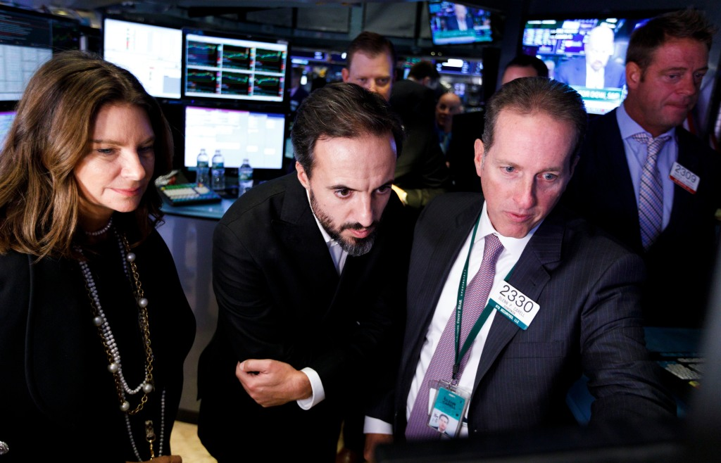 Jose Neves (C), the CEO of Farfetch, an online fashion house, talks with specialists during the company's IPO at the New York Stock Exchange in New York, New York, USA, on 21 September 2018.Farfetch IPO at New York Stock Exchange, USA - 21 Sep 2018