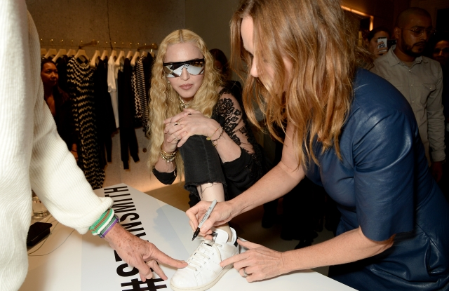 Madonna, StellaStella McCartney and Stan Smith sign Madonna's sneakers. McCartney and Stan Smith