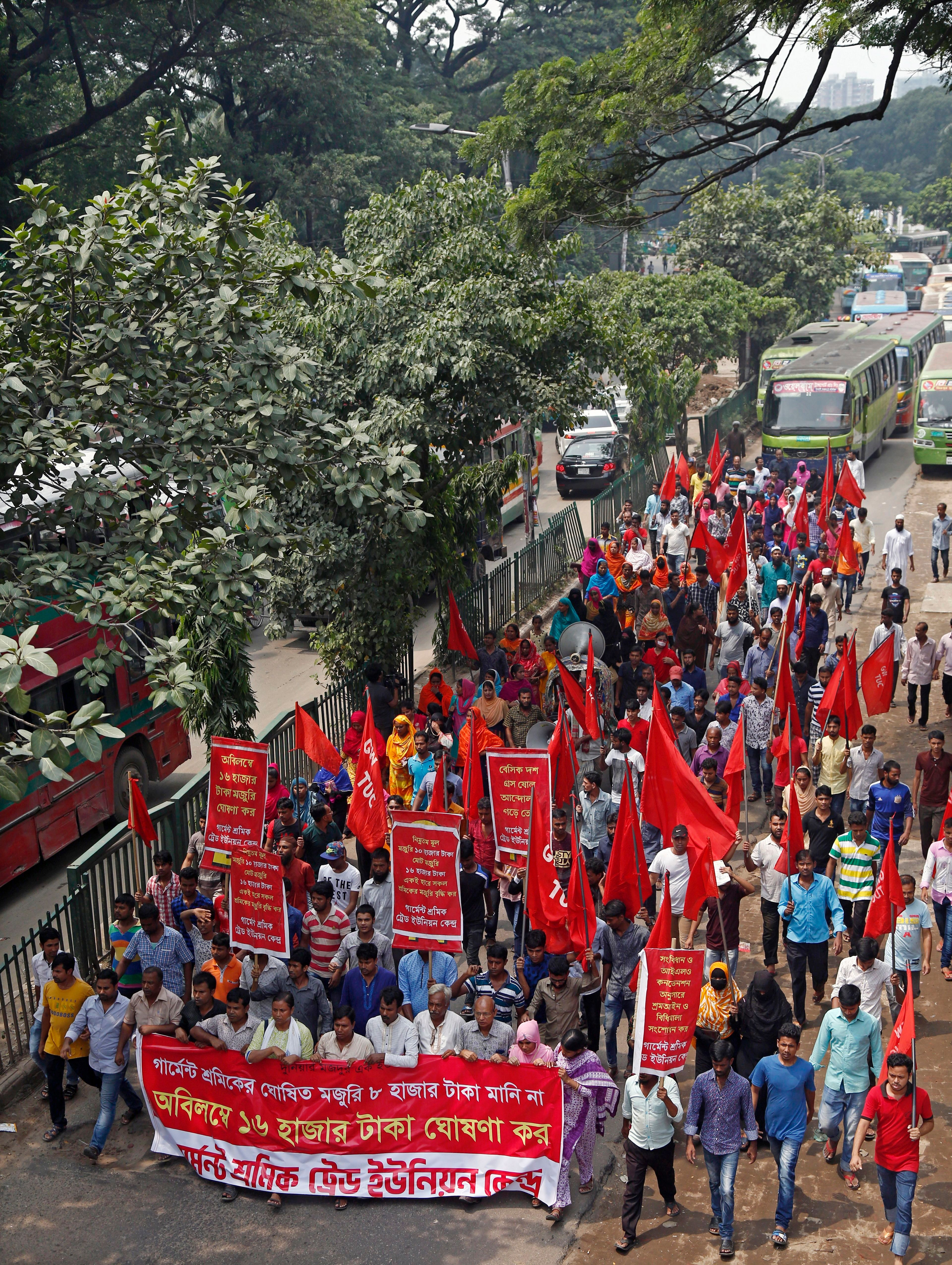 Bangladeshi garment workers shout slogans during a protest rally blocking a road in Dhaka, Bangladesh, 14 September 2018. According to media reports, workers from ready-made garment factories rejected the government's decision to raise their minimum monthly wage to 8,000 as they demanded instead a minimum monthly wage up to 16,000, for an estimate of 4.4 million garment workers.Garment workers stage demonstration over minimum wage in Bangladesh, Dhaka - 14 Sep 2018