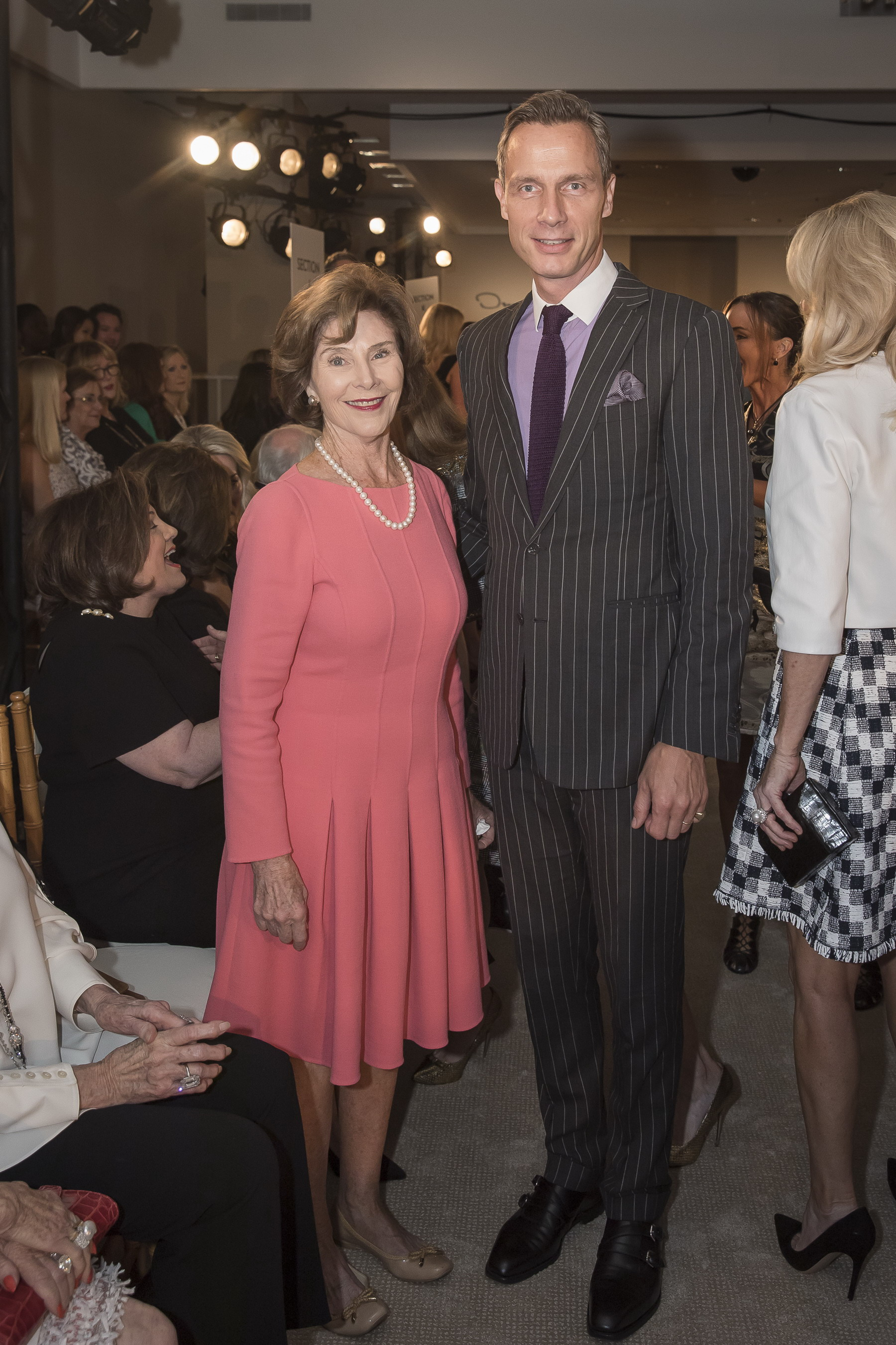 Laura Bush and Neiman Marcus CEO Geoffroy van Raemdonck at the Ten Best Dressed Women of Dallas Luncheon at the Neiman's flagship.