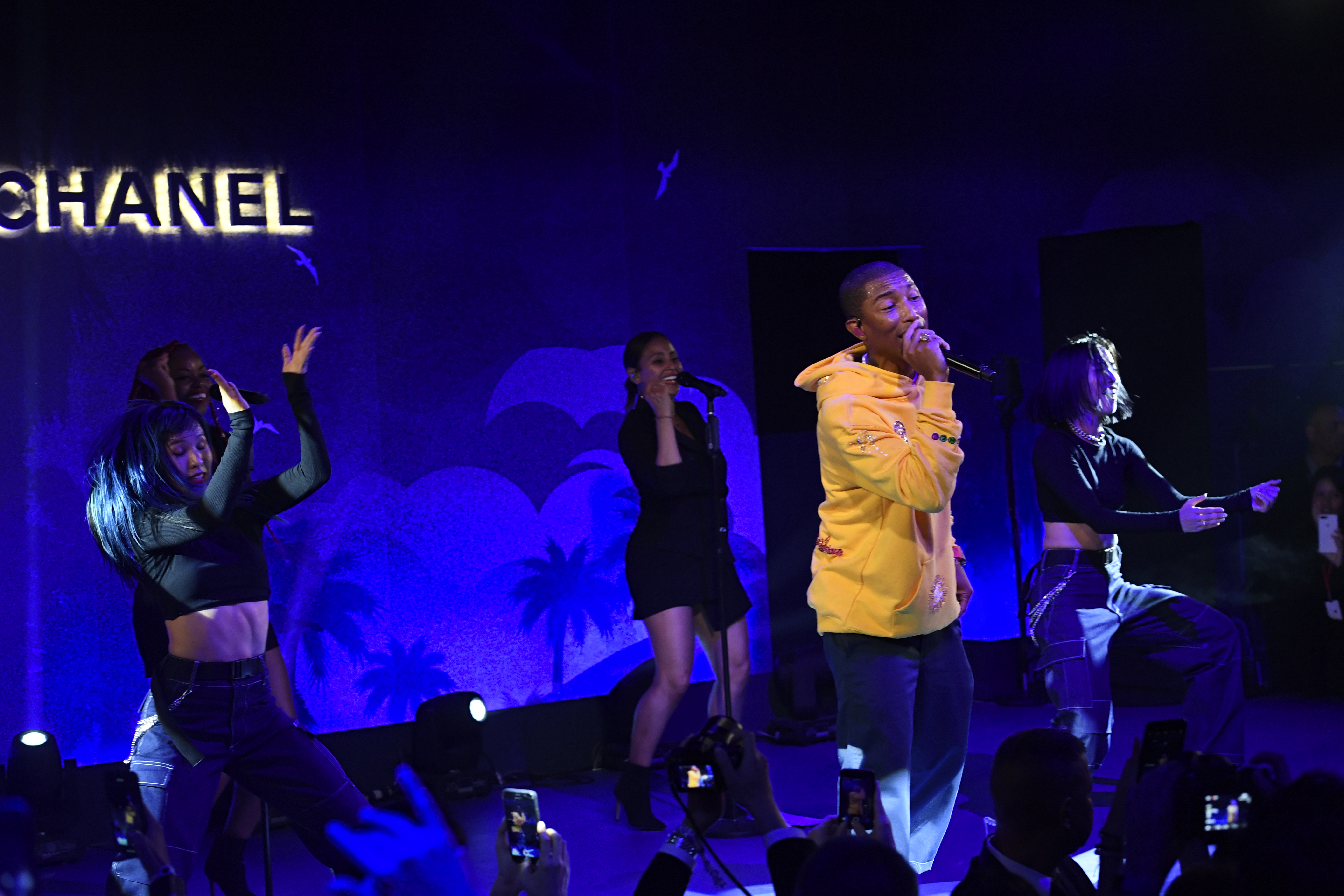 Pharrell performs in Bangkok, donning a piece from his new capsule with Chanel.