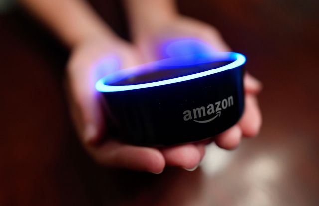 A child holds his Amazon Echo Dot in Kennesaw, Ga. Amazon updated its voice assistant with a feature that can make Alexa more kid-friendly. When the FreeTime feature is activated, Alexa answers certain questions differentlyAlexa Kids Test, Kennesaw, USA - 16 Aug 2018