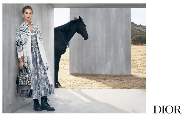 Dior's cruise 2019 ad campaign, lensed by Dutch photographer Viviane Sassen, features actress and muse Jennifer Lawrence in a wild and modern setting, joined by a black horse. In the images, the architectural lines of gray concrete walls set in a barren landscape contrast with the colors of the desert and dry grass. Lawrence's first campaign for the house was for spring 2013 for the Miss Dior handbag. Creative director Maria Grazia Chiuri for the cruise 2019 collection was inspired by Mexican horsewomen, the escaramuzas, including dresses and petticoats embellished with traditional embroidery. Toile de joy, updated with a series of wild animals, also plays a key role in the collection. Its motifs appear on coats, skirts and the Dior Book tote bag. The house's Saddle bag is also revisited in patchwork or Dior Oblique canvas finishes.