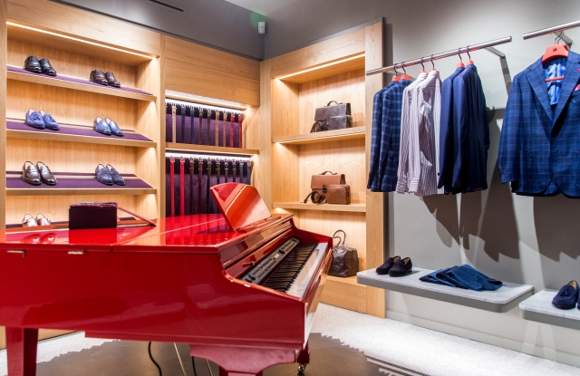 A red lacquered piano is a signature design feature in Isaia stores.