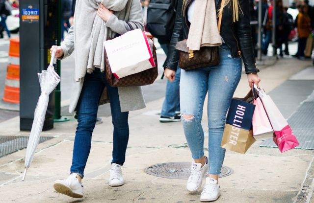 People carry shopping bags in New York, New York, USA, 27 April 2018. The United States Commerce Department's Bureau of Economic Analysis reported today that the US economy grew at an annual rate of 2.3 percent in the first quarter, which is slightly above the average yearly growth rate.US Economic Growth, New York, USA - 27 Apr 2018