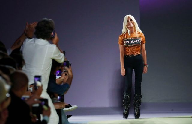 Donatella Versace comes on the catwalk at the end of Versace's women's 2019 Spring-Summer collection, unveiled during the Fashion Week in Milan, Italy, . Michael Kors is buying the Italian fashion house Gianni Versace in a deal worth more than $2 billion in a hard charge into the world of high end fashion. The deal announced Tuesday, Sept. 25, follows the New York handbag maker's $1.35 billion acquisition last year of the high-end shoemaker Jimmy ChooVersace Sale, Milan, Italy - 21 Sep 2018