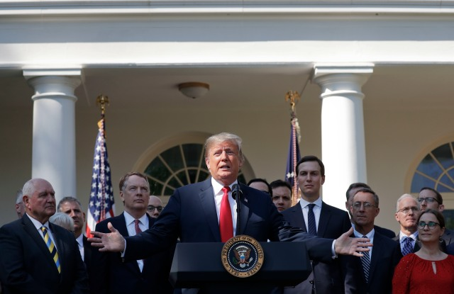 President Donald Trump, center, gestures as he announces a revamped North American free trade deal, in the Rose Garden of the White House in Washington, . The new deal, reached just before a midnight deadline imposed by the U.S., will be called the United States-Mexico-Canada Agreement, or USMCA. It replaces the 24-year-old North American Free Trade Agreement, which President Donald Trump had called a job-killing disasterNorth America Trade Trump, Washington, USA - 01 Oct 2018