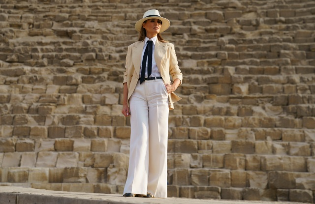 First lady Melania Trump pauses for photographs as she visits the historical site of the Giza Pyramids in Giza, near Cairo, Egypt. . First lady Melania Trump is visiting Africa on her first big solo international tripMelania Trump Africa, Giza, Egypt - 06 Oct 2018