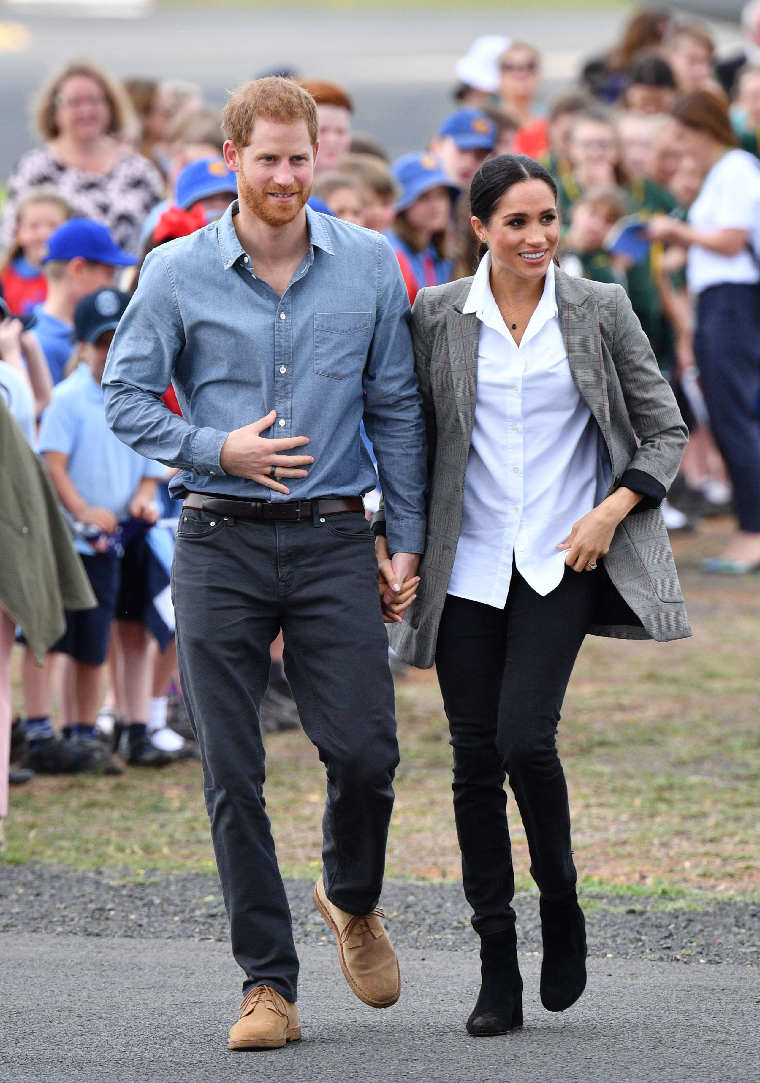 Pool - No RestrictionsMandatory Credit: Photo by Tim Rooke/REX/Shutterstock (9934576ab)Prince Harry and Meghan Duchess of SussexPrince Harry and Meghan Duchess of Sussex tour of Australia - 17 Oct 2018Greeted by the Mayor of Dubbo Region, Councillor Ben Shields and a welcoming party. Their Royal Highnesses will be meeting local school children.