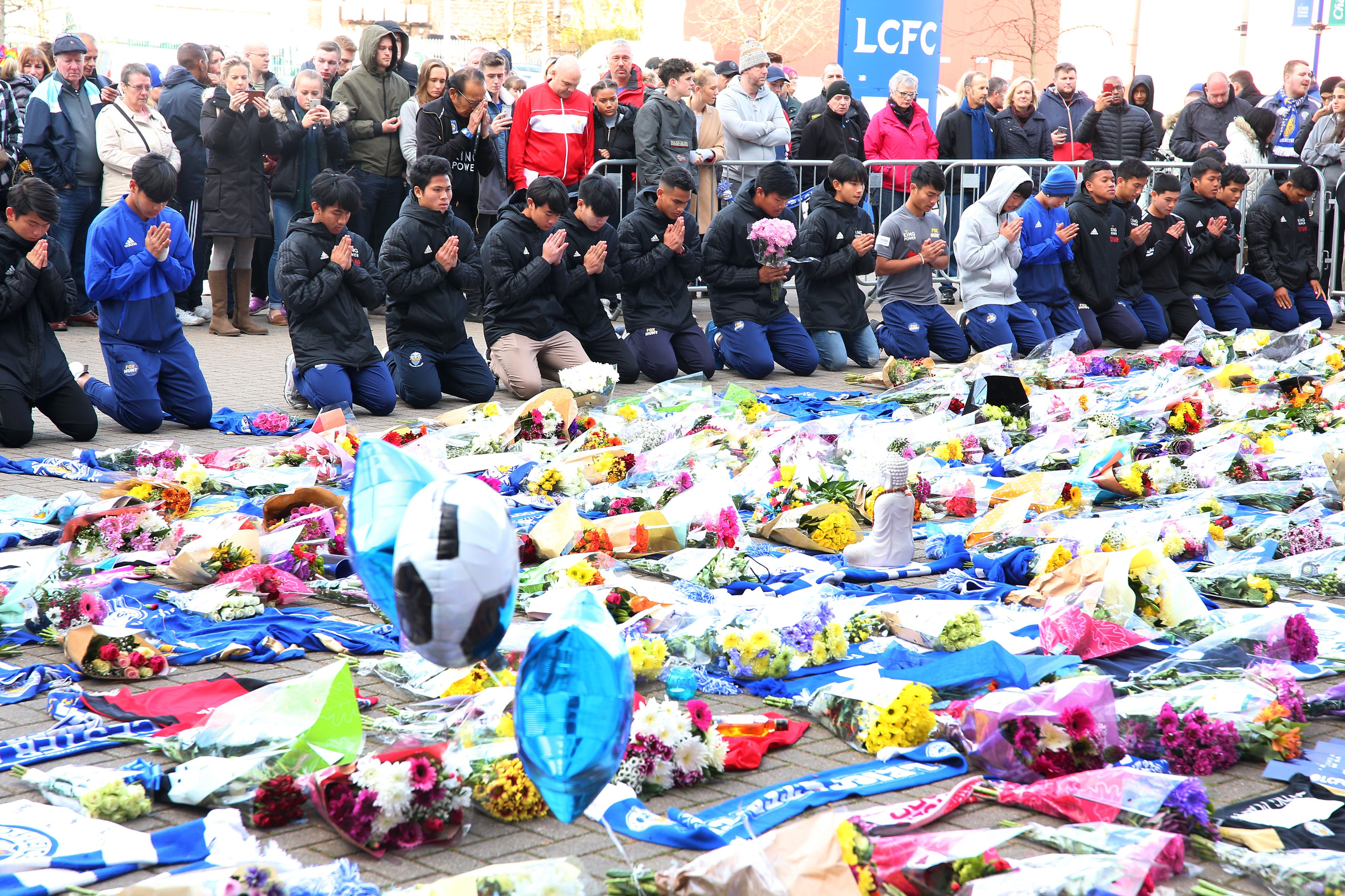 People pay respects outside the King Power stadium in Leicester, U.K on Oct. 28, 2018.
