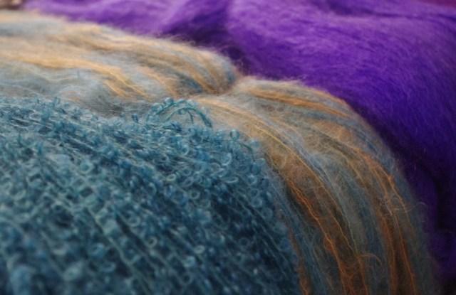 Assorted textured woolen yarns.
