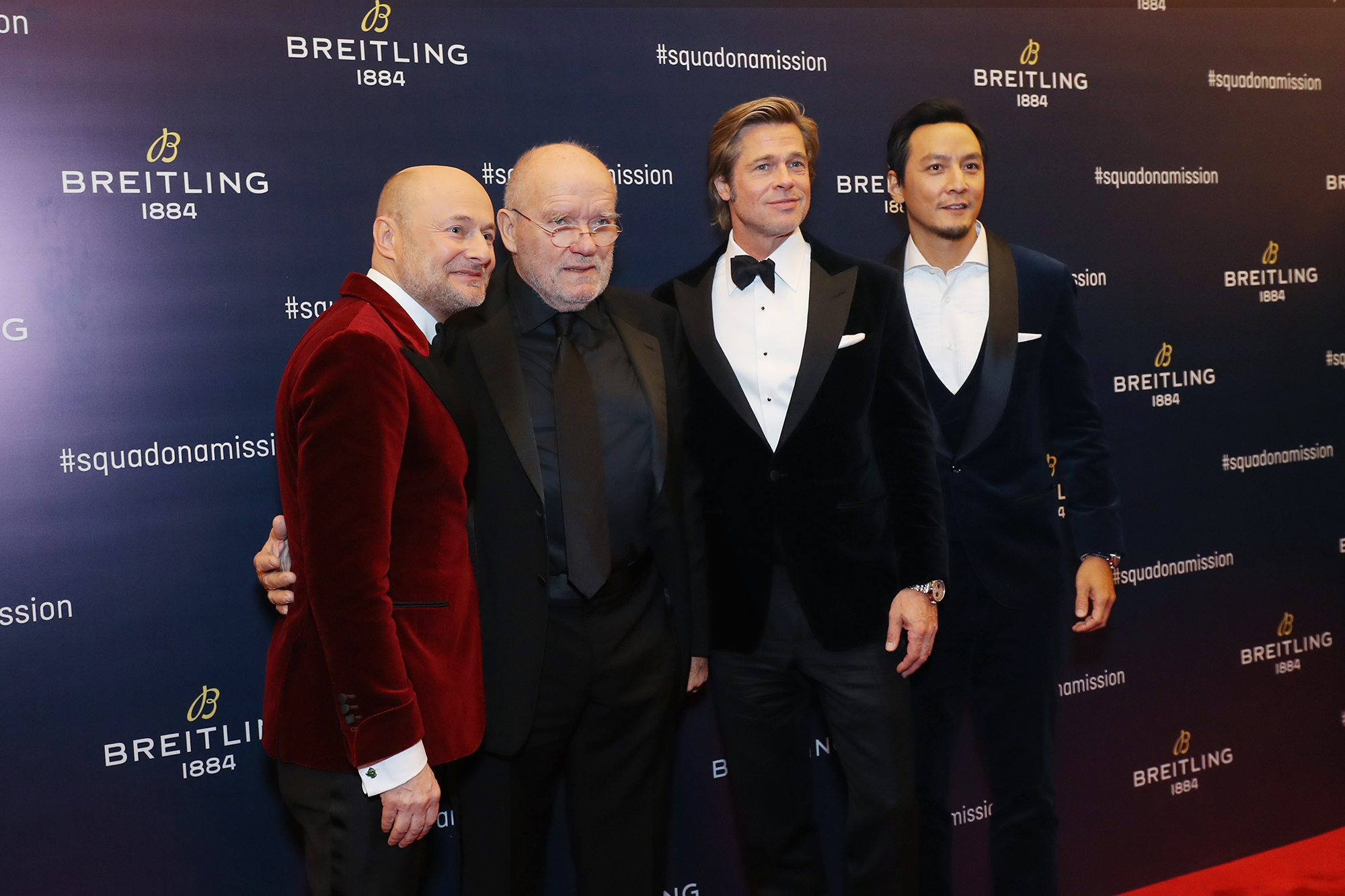 From left to right: Georges Kern, Peter Lindbergh, Brad Pitt, and Daniel Wu.