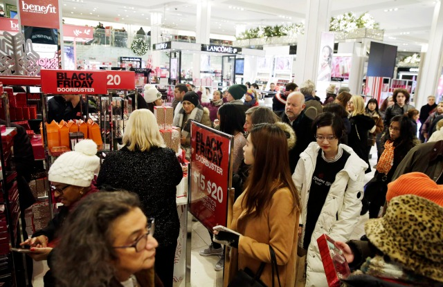 Bargain hunters seek low price deals during 'Black Friday' holiday shopping in MACY'S Herald Square in New York, New York, USA, 23 November 2018. Black Friday is the day after the USA Thanksgiving Day and is regarded as the start of the Christmas shopping season.Black Friday holiday shopping in New York, USA - 23 Nov 2018