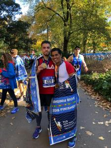 German Silva (right) and his son after the New York City Marathon on Sunday.