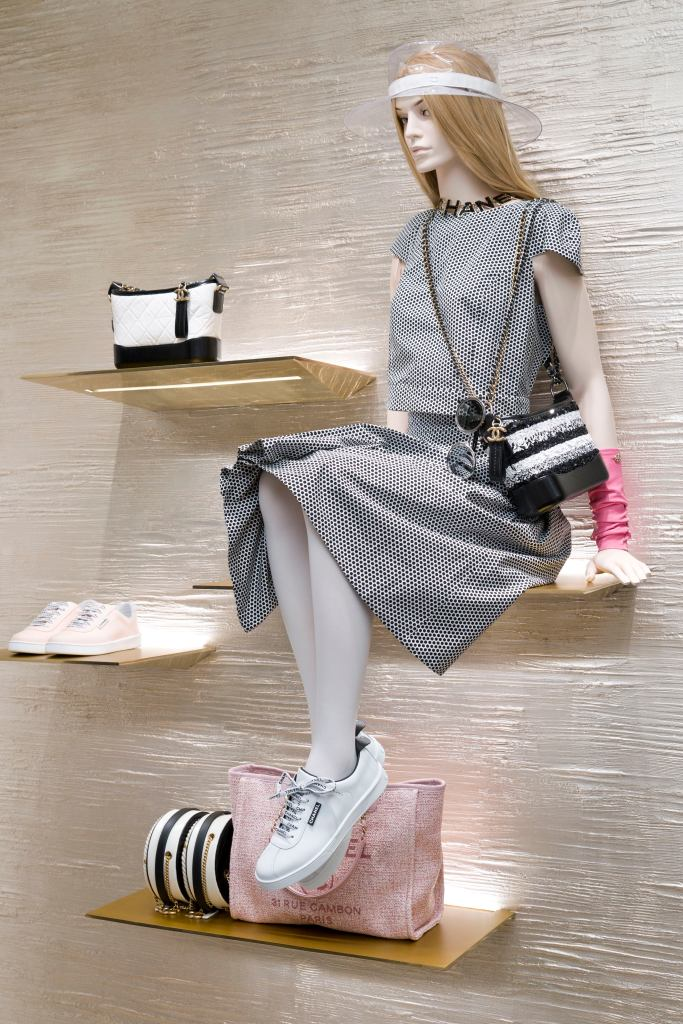 A mannequin on a display unit in the new Chanel flagship in Paris.