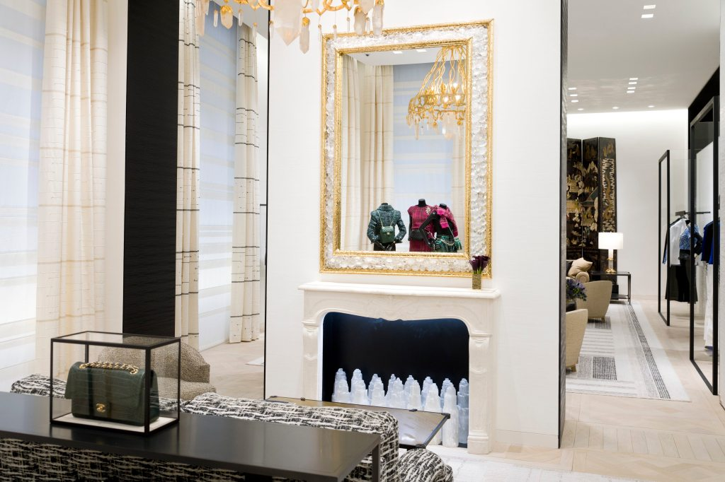 A Goossens mirror hangs over a marble fireplace in Chanel's new Paris flagship.