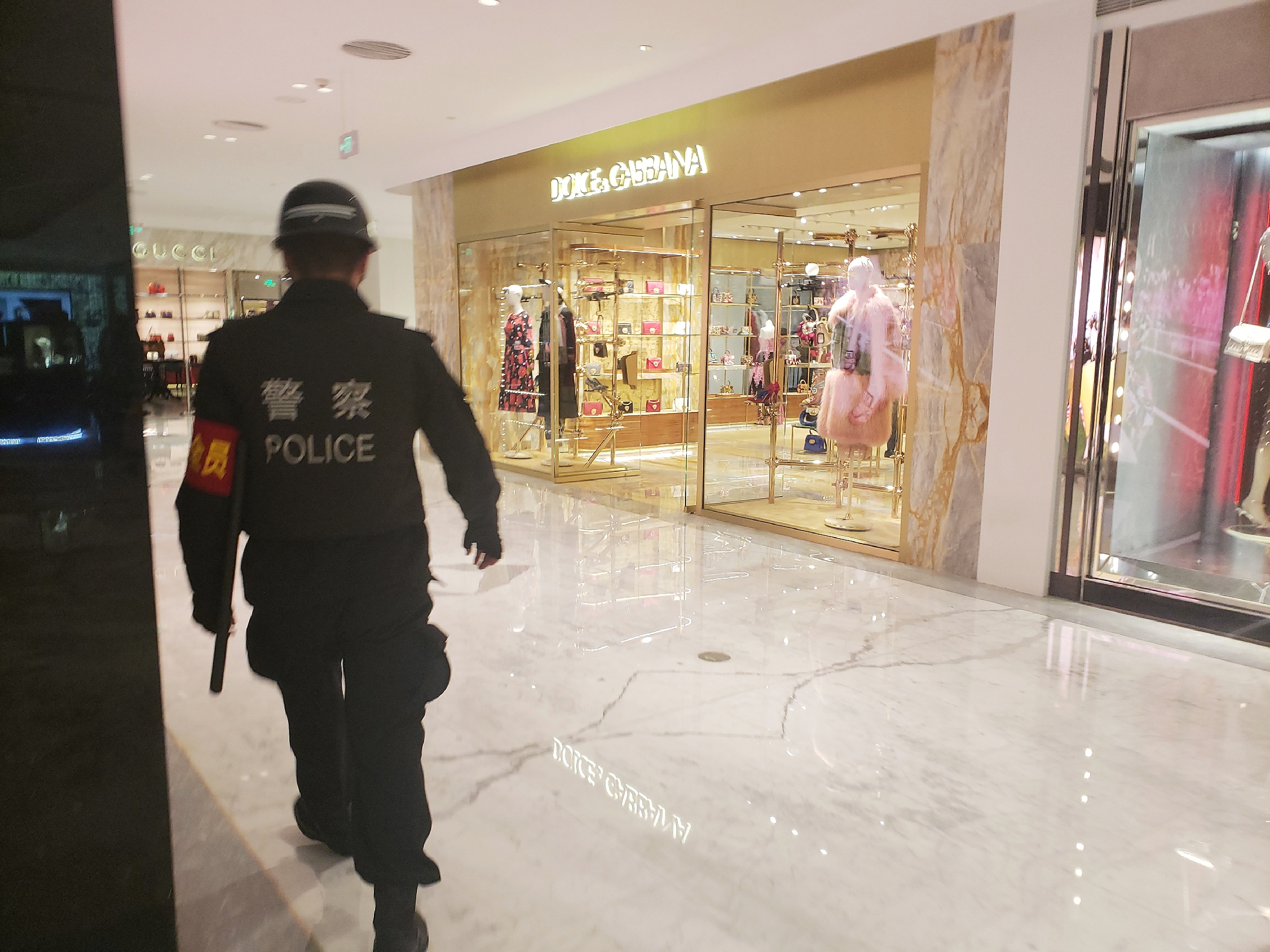 A police officer stands guard outside the Dolce & Gabbana store in SKP Beijing.