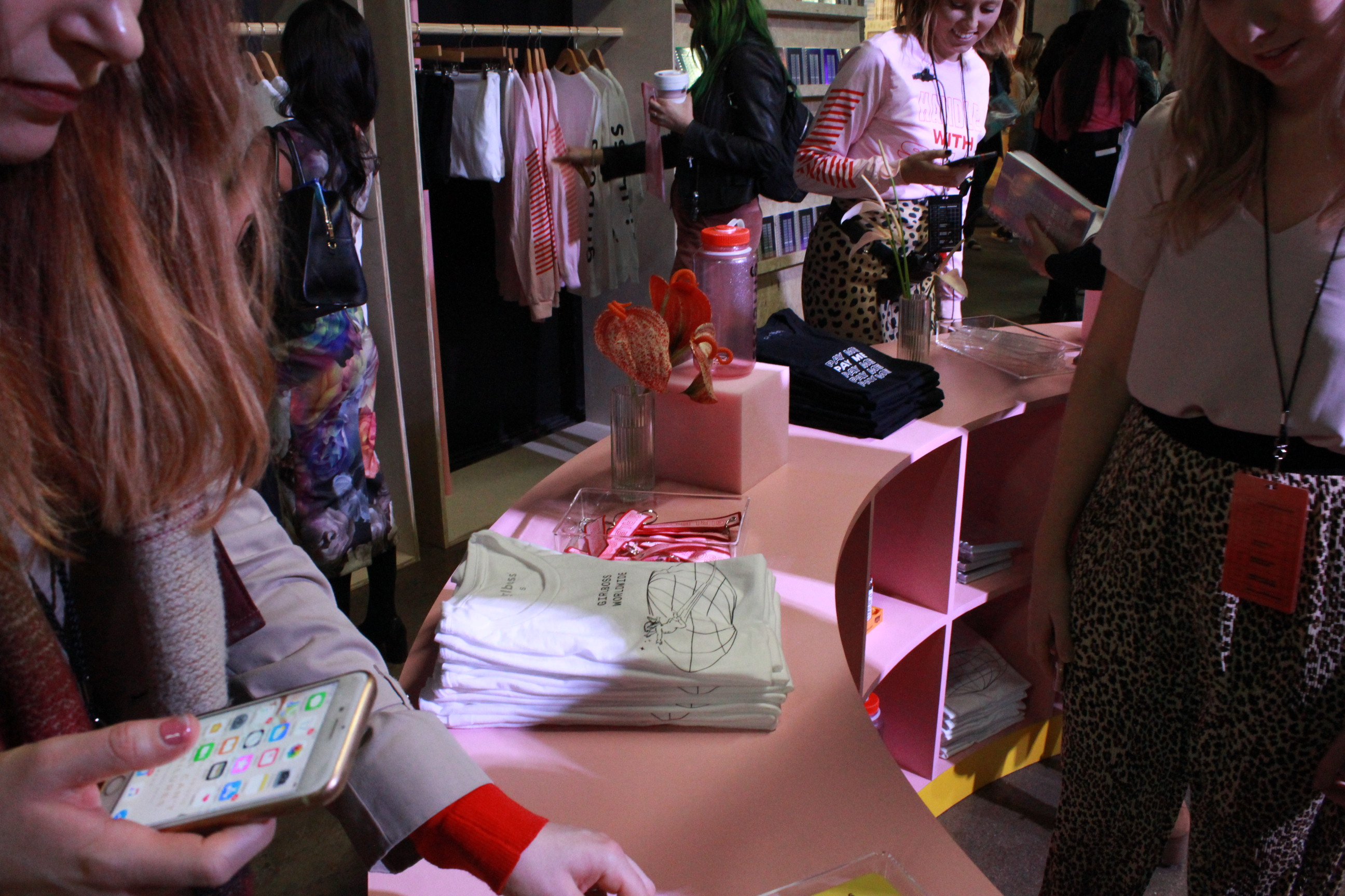Attendees shop through branded merchandise on day one of Girlboss Rally NYC.