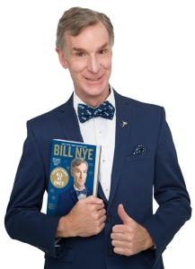 Bill Nye with the paperback version of his new book.