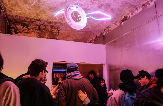 The scene at Wednesday's opening, with a sculpture by Makino hanging overhead.