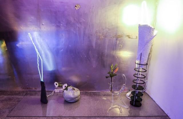 Neon sculptures and Ikebana arrangements by Mariko Makino.