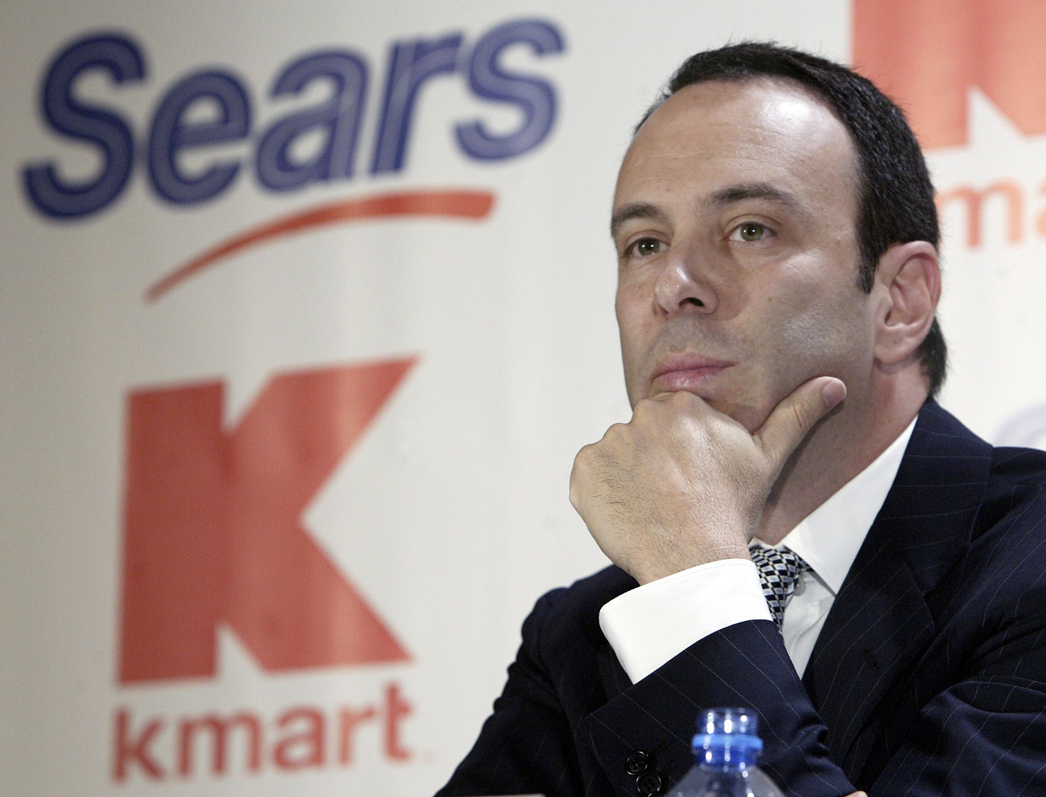 Kmart chairman Edward Lampert listens during a news conference to announce the merger of Kmart and Sears in New York . Kmart is acquiring Sears, one of the most venerable names in U.S. retailing, in a surprise $11 billion deal that will create the nation's third-largest retailerKMART SEARS MERGER, NEW YORK, USA