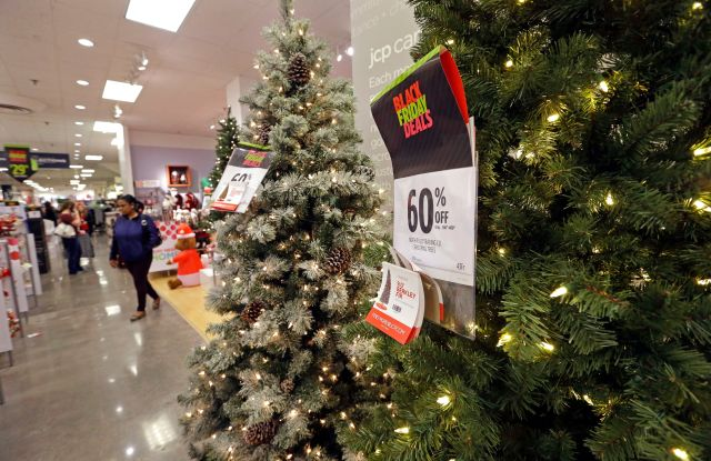 A shopper walks past a display of artificial Christmas trees at a JCPenney store, in Seattle. Black Friday has morphed from a single day when people got up early to score doorbusters into a whole season of deals, so shoppers may feel less need to be outHoliday Shopping Black Friday, Seattle, USA - 24 Nov 2017