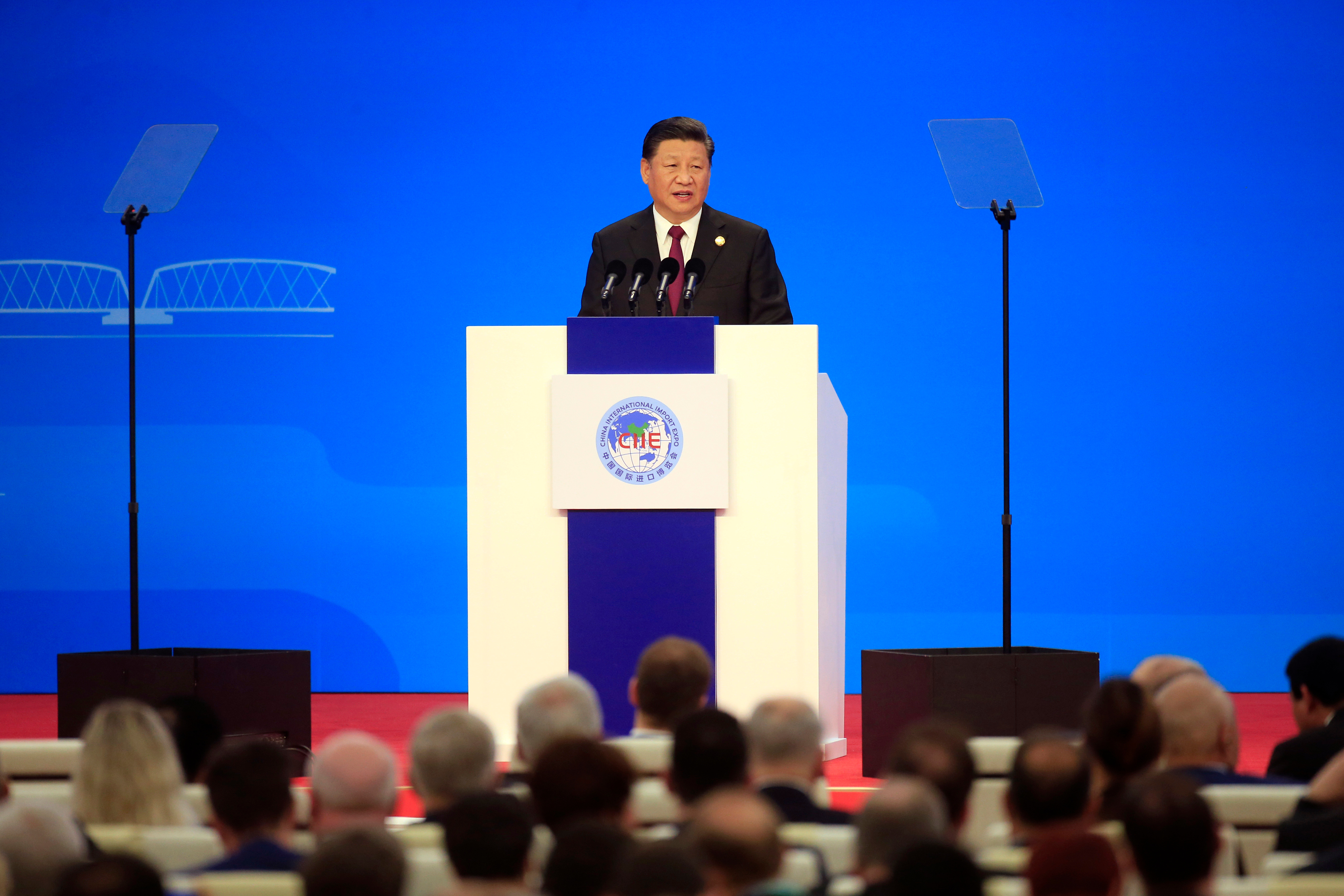 Chinese President Xi Jinping speaks at the opening ceremony for the China International Import Expo in Shanghai, . Xi promised Monday to open China wider to imports at the start of a high-profile trade fair meant to rebrand the country as a global customer but offered no response to U.S. and European complaints about technology policy and curbs on foreign businessImport Fair, Shanghai, China - 05 Nov 2018