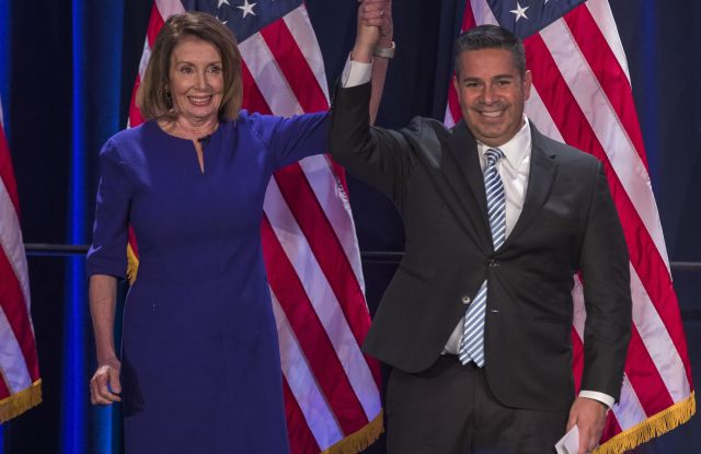 Democratic House Minority leader from California Nancy Pelosi (L) and Democratic Congressional Campaign Committee chair Ben Ray Lujan (R) from New Mexico react to early returns from the 2018 midterm general election during a House Democratic Election Night event at the Hyatt Regency in Washington, DC, USA, 06 November 2018.House Democratic leaders watch 2018 midterm election returns in Washington, DC, USA - 06 Nov 2018