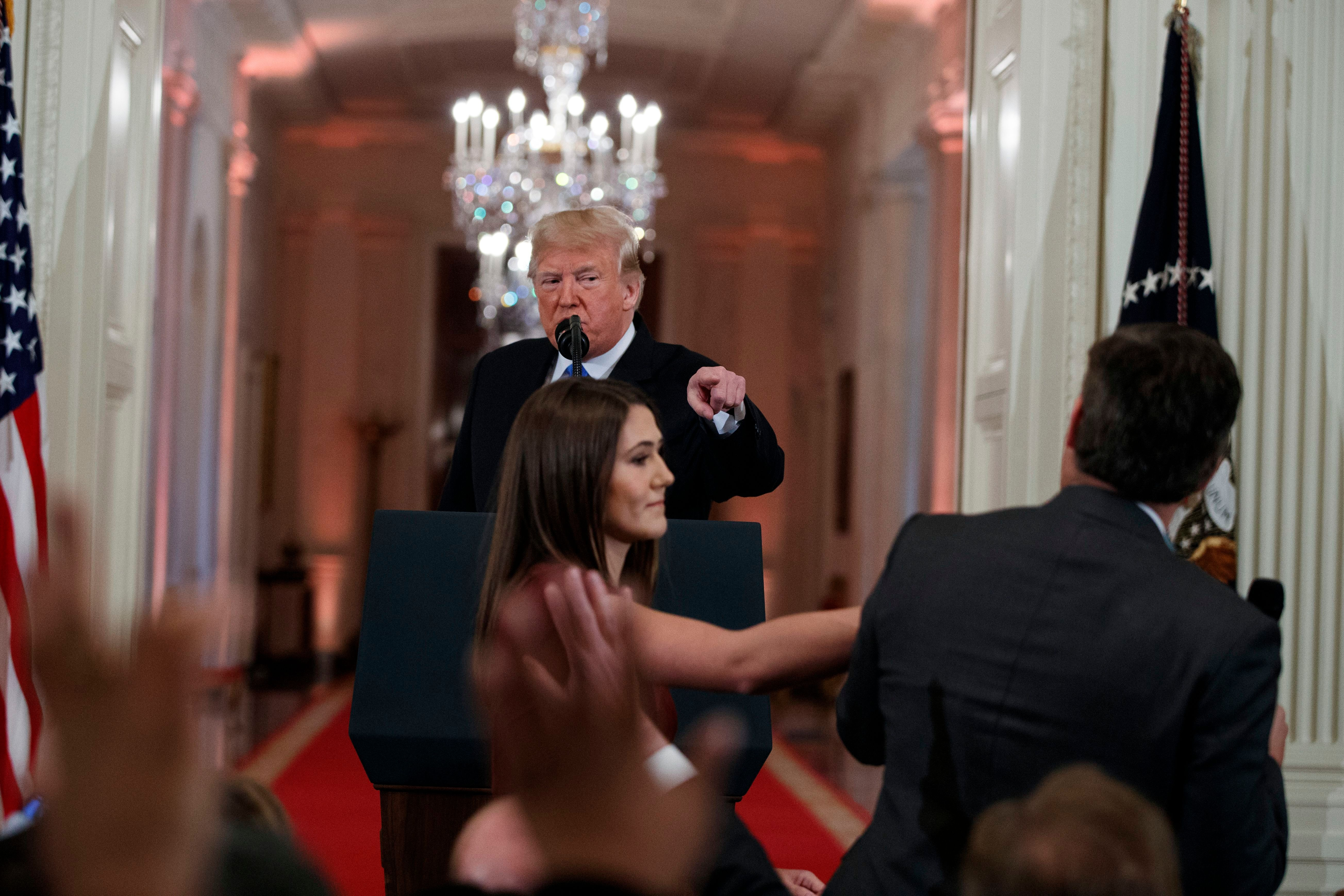 Donald Trump, Jim Acosta. President Donald Trump watches as a White House aide reaches to take away a microphone from CNN journalist Jim Acosta during a news conference in the East Room of the White House in Washington. CNN is suing the Trump administration, demanding that Acosta's press credentials to cover the White House be returned. The administration revoked them last week following President Trump's contentious news conference, where Acosta refused to give up a microphone when the president said he didn't want to hear anything more from himMedia CNN vs Trump, Washington, USA - 07 Nov 2018
