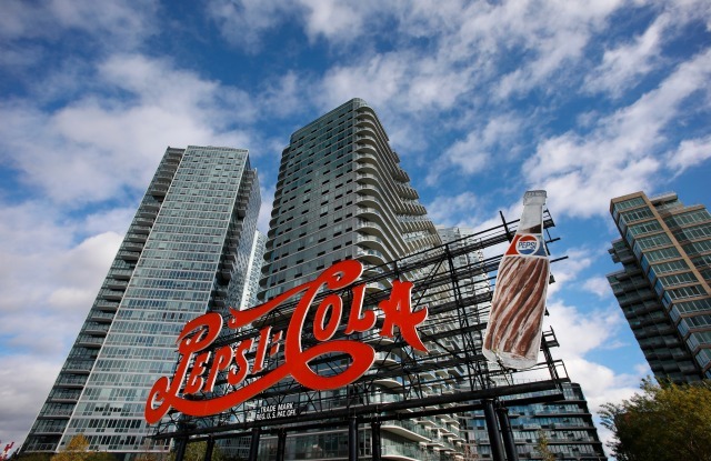 A landmarked PepsiCola sign stands in Long Island City near the site for a proposed Amazon headquarters in the Queens borough of New York, . The sign previously was part of a former bottling plant nearby. City and state officials promised at least $2.8 billion in tax credits and grants to lure Amazon to Queens, where it would occupy a new campus built around a formerly industrial boat basinAmazon HQ , New York, USA - 16 Nov 2018