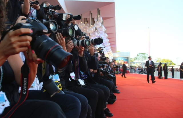 Photographers walk the red carpet ahead of the Award Ceremony during the 75th Venice Film Festival at Sala Grande on September 8, 2018 in Venice, Italy.
