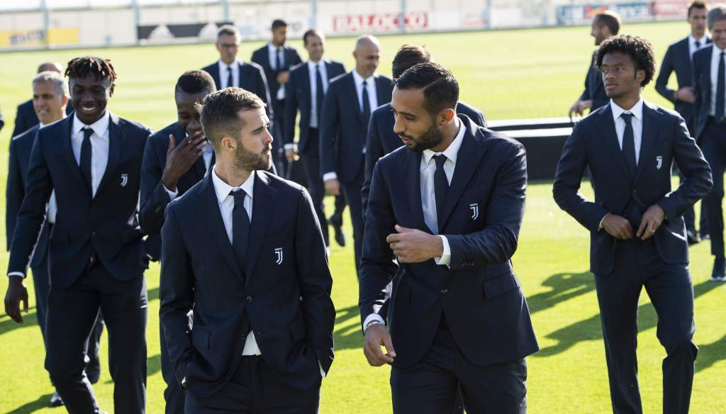 Turin's Juventus soccer players dressed with off-the-field uniforms by Trussardi.