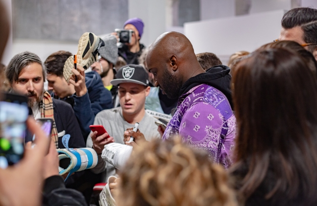 Virgil Abloh signing shoes at Spazio Maiocchi in Milan