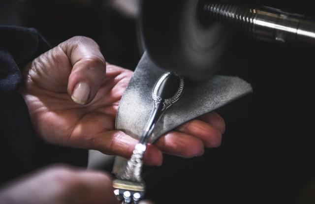 A Buccellati silversmith working at the dedicated hub.
